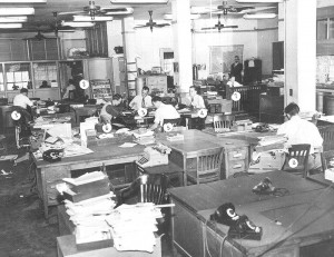 An old-school newsroom, when reporters played pranks by switching the numbers on each other's desks.
