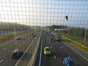 View of motorway outside of Newcastle, England, from a bridge over the carriageway.