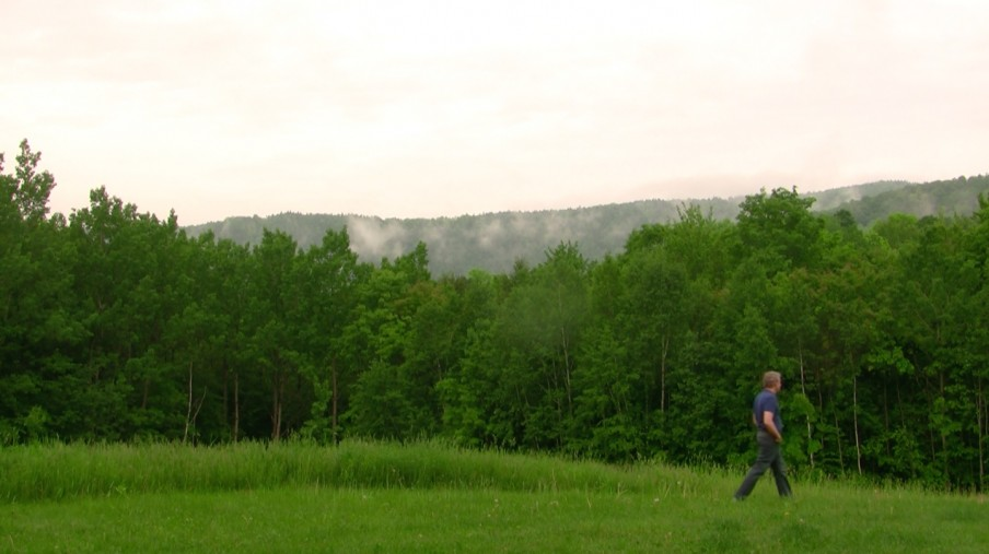 Chris Orcutt walking in Vermont's Green Mountains, photo by Chris Orcutt